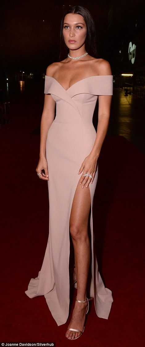 Red carpet or runway? The rising catwalk queen flashed a hint of her tanned skin thanks to the wraparound numbers fitted cut, while a thigh-high slash in the gown ensured that her endless legs also took a share of the limelight