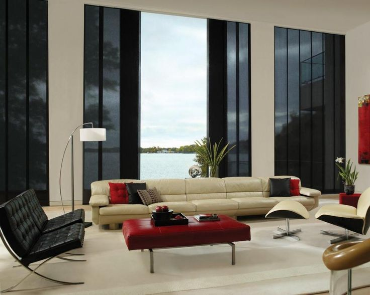 http://www.drissimm.com/wp-content/uploads/2014/12/elegant-modern-living-room-with-houseplants-also-classic-beige-leather-sofa-plus-red-benches-table-on-rug-including-lounge-chair-also-black-blind-window.jpg