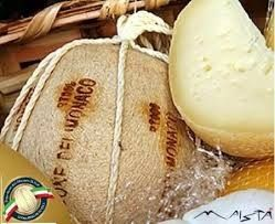 PROVOLONE DEL MONACO AGED CHEESE PDO   Provolone del Monaco cheese is a valuable product in the Sorrento Peninsula - Lattari, only with raw milk. It 'a semi-hard cheese made of spun paste and aged for periods ranging from 6 to 18 months.