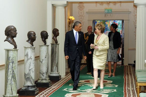 Michelle Obama and Barack Obama Photos - U.S. President Barack Obama and Irish President Mary McAleese speak while walking through the Francini corridor in Aras an Uachtarain, the official residence of the President of Ireland, ahead of Dr. Martin McAleese and first lady Michelle Obama May 23, 2011 in Dublin, Ireland.  Obama is visiting Ireland for one day. He will meet with distant relatives in Moneygall and speak at a rally in central Dublin after a concert. - US President Barack Obama…