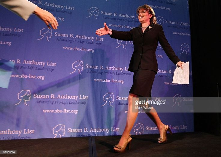 Former Gov. Sarah Palin (R) walks onstage to speak at the Ronald Reagan Building on May 14, 2010 in Washington, DC. Sarah Palin was the guest speaker at the Susan B. Anthony List 'Celebration of Life' breakfast.