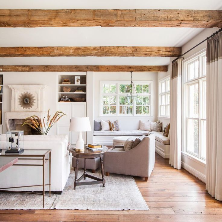 A+built-in+window+seat+is+situated+in+the+corner+of+this+elegant+living+room,+creating+a+relaxing+spot+full+of+natural+light.+Built-in+bookshelves+flank+the+traditional+fireplace,+while+a+grouping+of+comfortable,+oversized+furniture+makes+for+great+conversation+and+entertaining+space.+