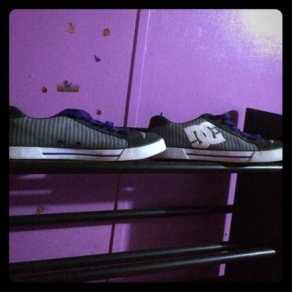 DC skate shoes DC skate shoes grey on grey stripes with purple shoelaces. DC Shoes