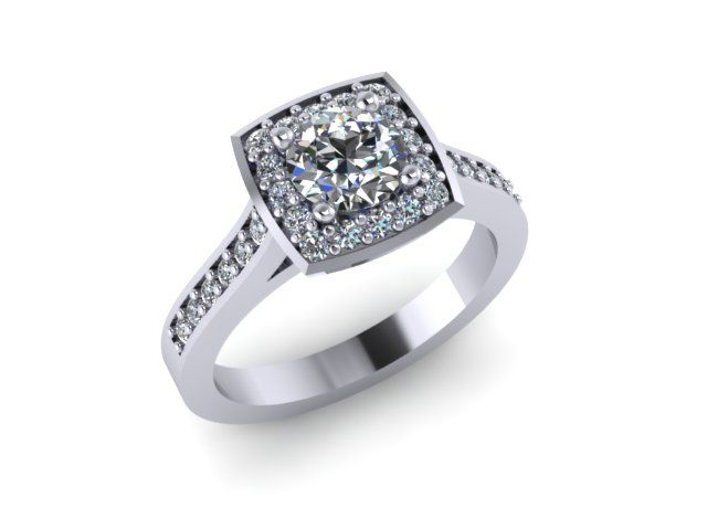 This engagement ring features a round center stone in a cushion-shaped halo. The prong placement on a round stone makes it the perfect candidate for this style. Custom-made here at Wyatt Austin Jewelers.