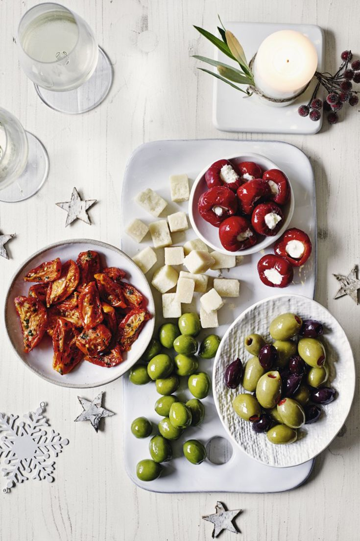 A delicious antipasti platter with a mix of Greek olives, Parmesan cheese, Nocellara olives, dried tomatoes and stuffed cherry peppers. Order this platter and more delicious nibbles online at Waitrose Entertaining. Pinterest: Jess Barnett