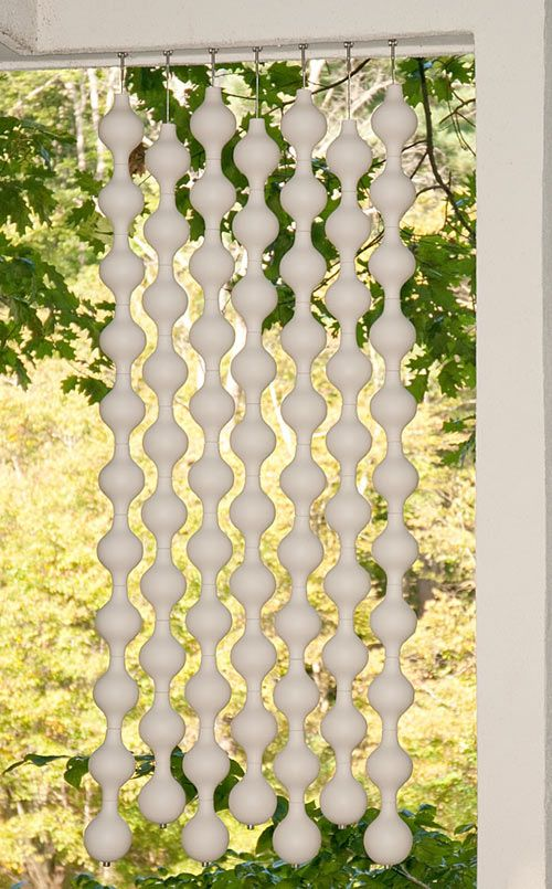 """Jim Schatz is back with an indoor/outdoor hanging """"curtain"""" made of translucent porcelain. Called Happening Curtains, these sun-capturing orbs would make a great porch hanging, but could also be used as a room divider, over the inside of a window, or even on a wall as art."""