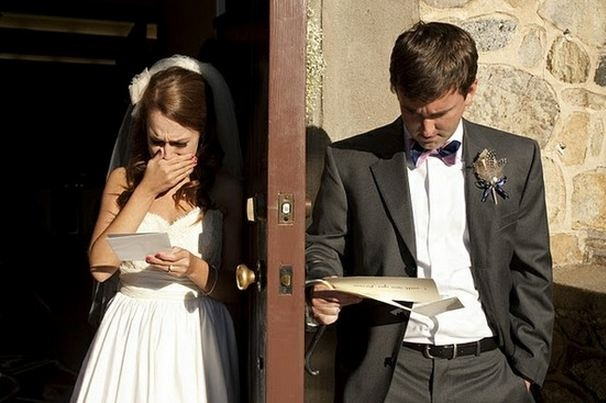 Minutes before the ceremony, a bride and groom swap notes and read them on either side of their church door
