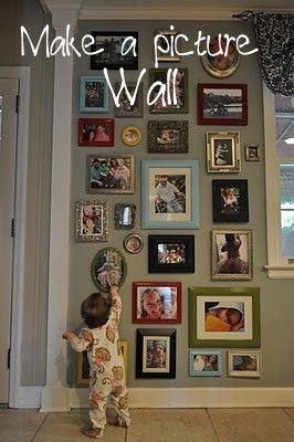 Picture Wall!  YES!!! This is EXACTLY how I imagine my smorgasbord-travel-photos-random wall will look! Except not just photos but also travel paraphernalia from everywhere. :)