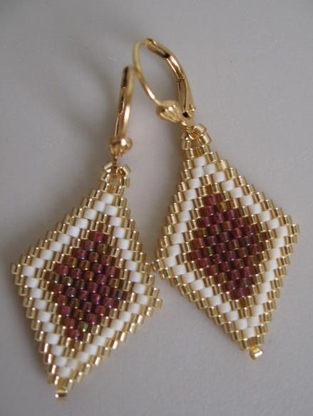 These pretty, petite, & lightweight beadwoven earrings are handmade with transparent raspberry gold rainbow luster, matte cream, & golden delica seed