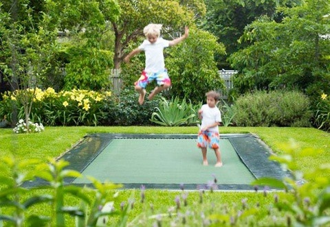 my dad did this for us when we were kids... dug up the earth to fit our huge trampoline in so if we fell off we wouldnt be hurt. id ALWAYS do this if my kids ever got a trampoline. #trampoline #kid #outside kiddos