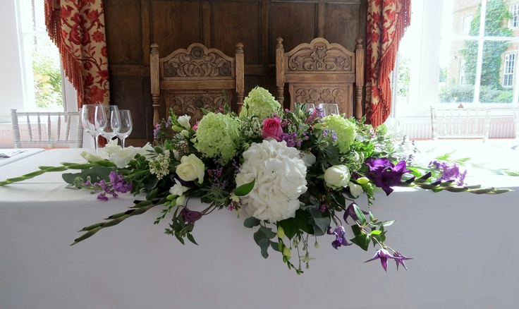 Top Table design with big blousey hydrangeas and gladioli
