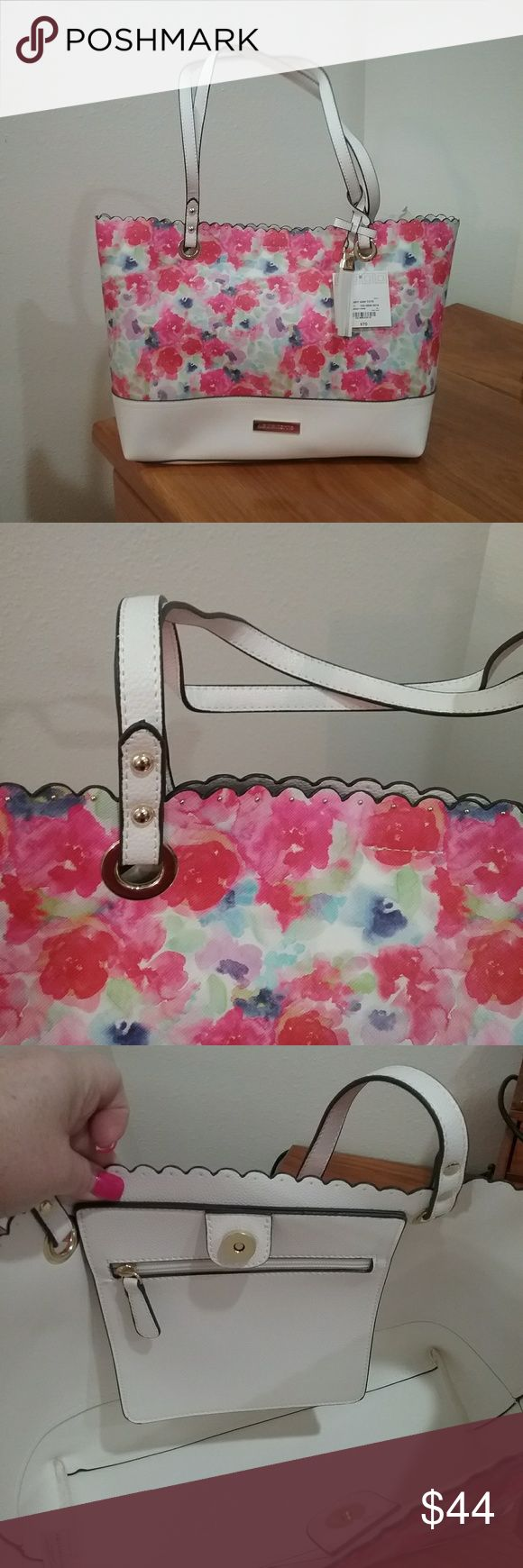 BNWT adorable purse! Brand new Liz Claiborne Mary Ann Tote in a pop of colors including pinks, lavenders, blues, greens and white.  Beautifully scalloped edging with gold tiny dots.  Snap closure with zippered pocket on the inside.  Comes with cute tassel charm on the handle.  Size is 11 1/2 inches long by 17 1/2 inches wide.  So pretty! Liz Claiborne Bags Totes