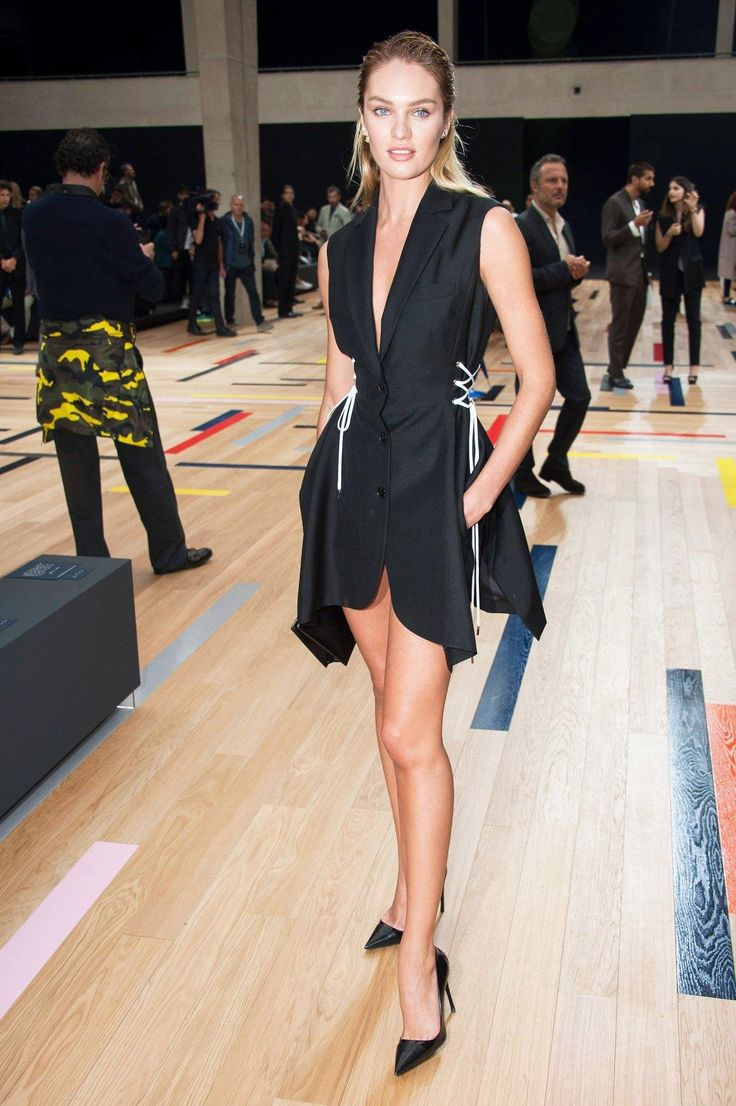 Model and VS Angel, Candice Swanepoel in a black fit-n-flare dress
