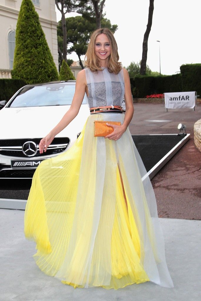 With a yellow, color-blocked skirt and unexpected belted waist, Candela Novembre's floaty dress was a modern way to incorporate a dash of fun at amfAR's 21st Cinema Against AIDS Gala in Cannes, France. [Photo by Gisela Schober/German Select for Mercedes-Benz]