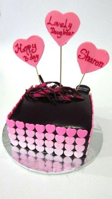 Chocolate Mirror glaze cakr with pink fondant hearts by Bread Choice Bakery (Instagram: @breadchoicebakery)