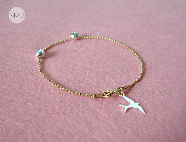 Minimalist bracelet with cute swallow near buckle and elegant, crushed balls. Made entirely of sterling silver, gold-plated.