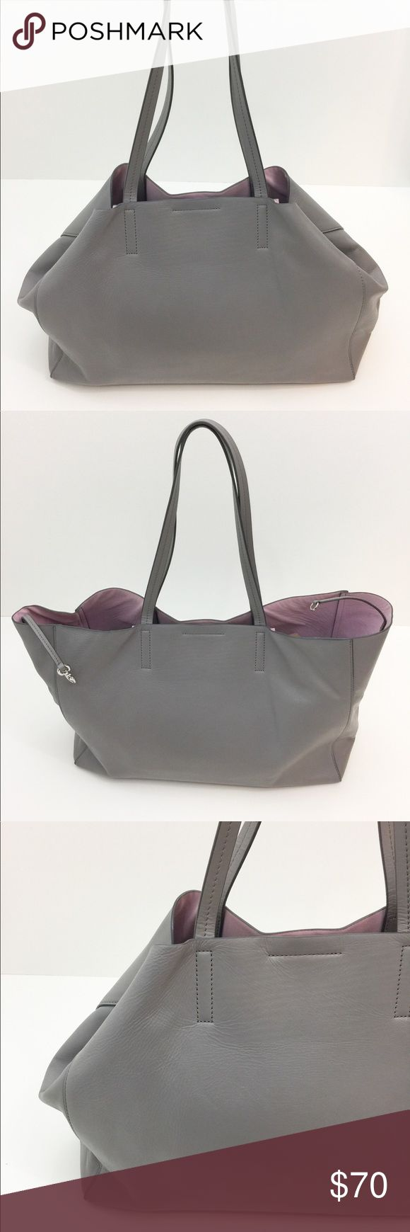 """Banana Republic Gray Larking Large Tote Bag Banana Republic Larkin large gray tote with light pink nu-buck leather lining. Overall in pretty good condition - about 2 years old worn in the summer and fall only. The inside is clean with some very light signs of wear and minor stains from pens/lotion. One side features a small pocket for cellphone/makeup (on the inside of the bag) No tears or rips or any types of damages. - bag height with handle: 21"""" - bag height w/o handle: 10"""" - handle…"""