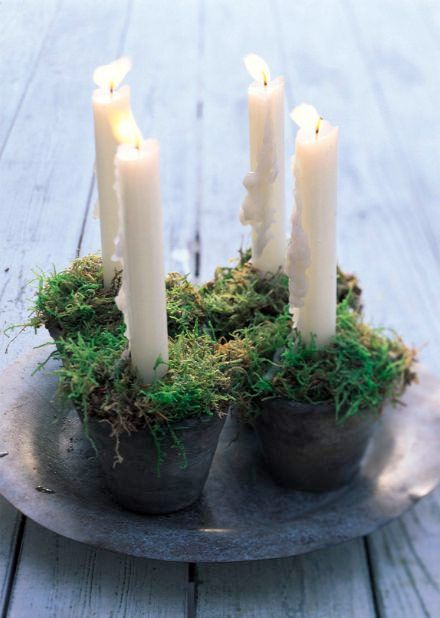Moss and candles..l.Adventsljusstake
