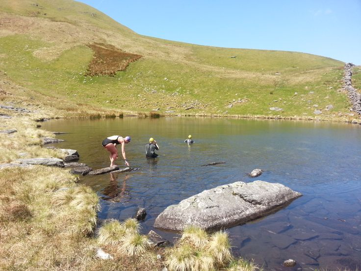 """There's something about this photo - the reminds us of the """"evolution of man"""" imagery.  It quite appeals.  Taken in a beautiful lake we refer to as """"the baby bear"""" on our Snowdonia Wet Weekend.  http://www.goneswimming.co.uk/wet-weekends.html"""