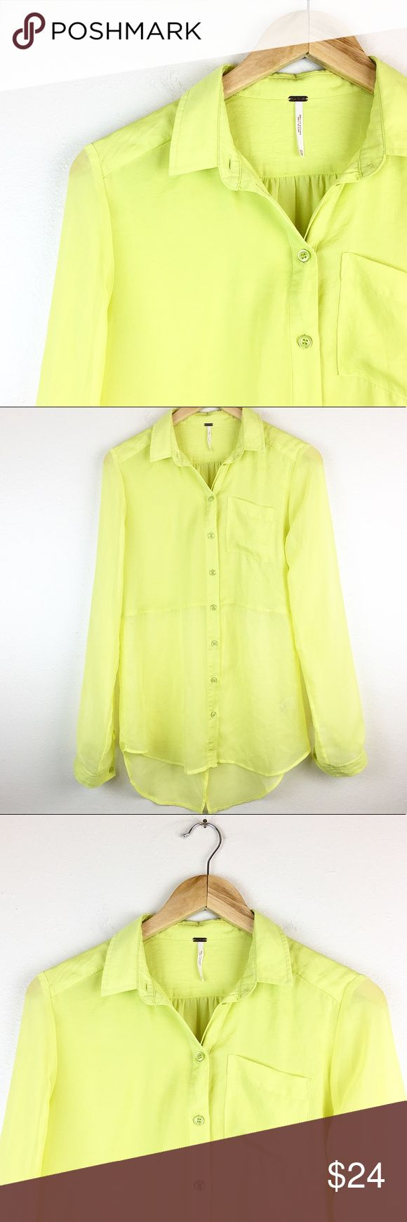 """Free People Women's Size XS Button Down Blouse Free People women's button down blouse, vibrant green/yellow color. Top is sheer and has longer back that opens. Small spot on back of shirt, did not come out in wash, not too noticeable.   Measurements: Bust - 19"""" armpit to armpit Sleeve Length - 25"""" Length - 32"""" taken from back of garment, top to bottom  HAPPY POSHING!  storage code: F14 Free People Tops Button Down Shirts"""