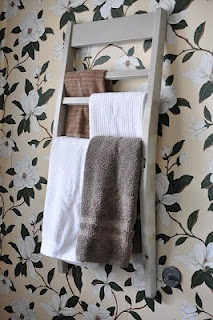 Use the back of a chair as a towel rack