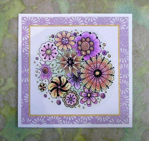 Florabunda card coloured with coloured pencils. Circular flower design.