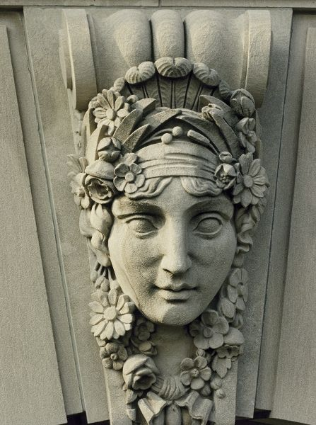 Flora, the Roman goddess of flowers is a decorative mythological face on exterior of botanic garden conservatory building. 07/14/1993