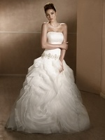 The skirt of this dress will literally make it look like you are floating on a cloud down the aisle. So pretty. Mia Solano #Wedding #Dresses - Style M1249L - http://thealternativebride.com