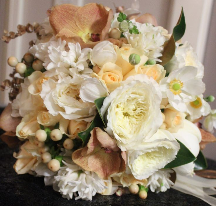 Glamourous  Ivory and Copper tone wedding bouquet with Vanda Orchid, David Austin Roses, Hyacinth, Hypericum and Windflower. Created by Poppies and peas Floral Design