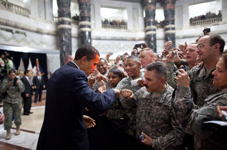 Obama fist-bumps a U.S. soldier as he greets hundreds of troops during his visit on April 7, 2009, to Camp Victory, Iraq.