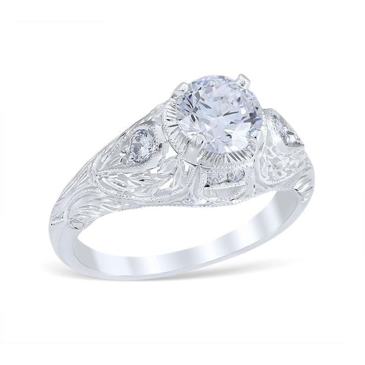 <p>Wreathed Pear engagement ring showcasing a pierced wreath of engraved leaves to accent bead set diamond pear shape shoulders.</p> <p><br />MSRP 14K: $2,125.00<br />MSRP 18K: $3,170.00<br />MSRP Plat: $4,025.00<br /><em>(Not including center diamond)</em></p> <p><br />Center Diamond Carat Range: 0.75-2.00ct.<br />Total Weight: 0.17 ctw.<...