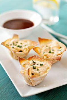 Baked Crab Rangoon: 12 Won Ton wrappers in mini muffin tins filled with mixture of 1 can (6 oz.) white crabmeat, drained and chopped  4 oz. softened cream cheese, 2 tablespoons light mayonnaise, finely slice chives, fresh ground pepper to taste. Garnish with a sprinkle of chives. Bake 15-20 min. at 350 degrees until lightly golden and warm. YUM!