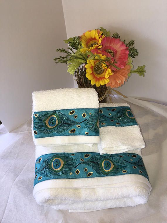 Decorative white with peacock and Trim Towels