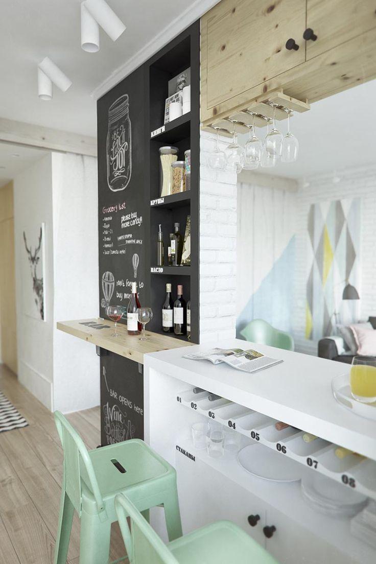 aprovechamiento del espacio en la pared de la cocina. Botellero debajo de la barra. Cocina - AD España, © INT2architecture