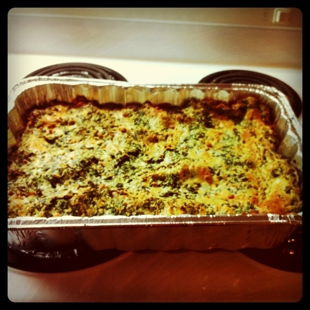 12wbt lasagne - 1 cup reduced fat ricotta - 250g packet of frozen spinach, thawed, with the excess liquid squeezed out - 1 egg - 30g shredded parmesan - pinch of ground nutmeg - olive oil spray - 1 onion, diced - 800g mushrooms (YES, you did read that right. It's a truckload!) - 2 gloves garlic, finely chopped - 220g lean beef mince - 400g can of crushed tomatoes - 2 medium tomatoes, chopped - 1 zucchini, coarsely grated - 1 carrot, coarsely grated - 3 fresh lasagne sheets