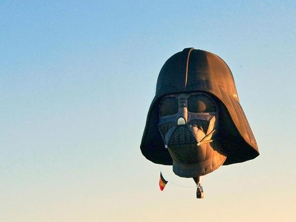 Stange hot air ballon int he sky