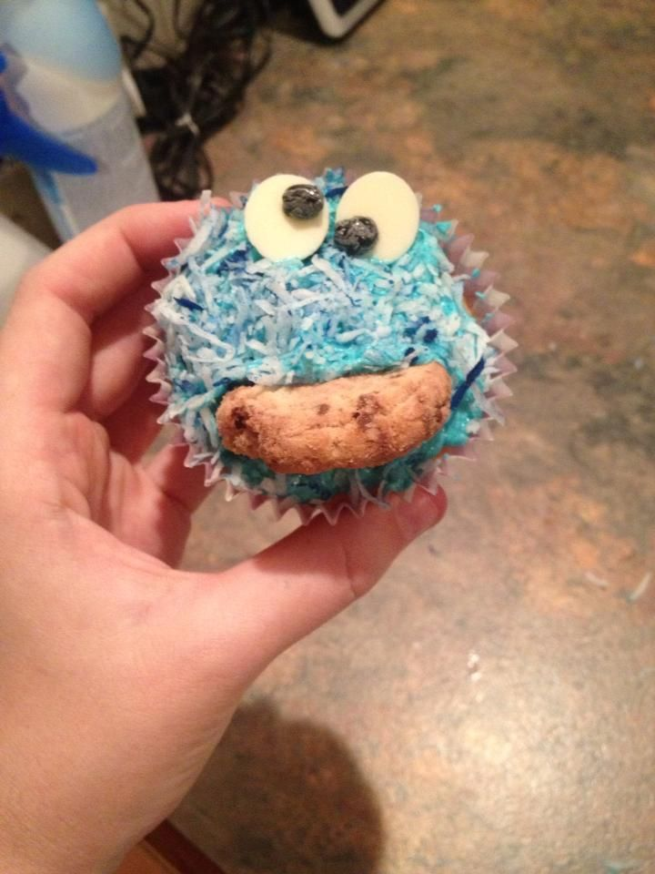 Experimented with Cookie Monster cupcakes! Vanilla cupcake & buttercream that was dyed blue. Also dyed some shredded coconut blue to sprinkle on top. Used white chocolate buttons for the eyes and black gel icing for the pupils.. then inserted half a chocolate chip cookie! :)