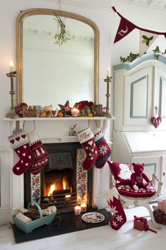 Christmas butning and stockings by the fire. #Christmas, #stockings, #fireplace