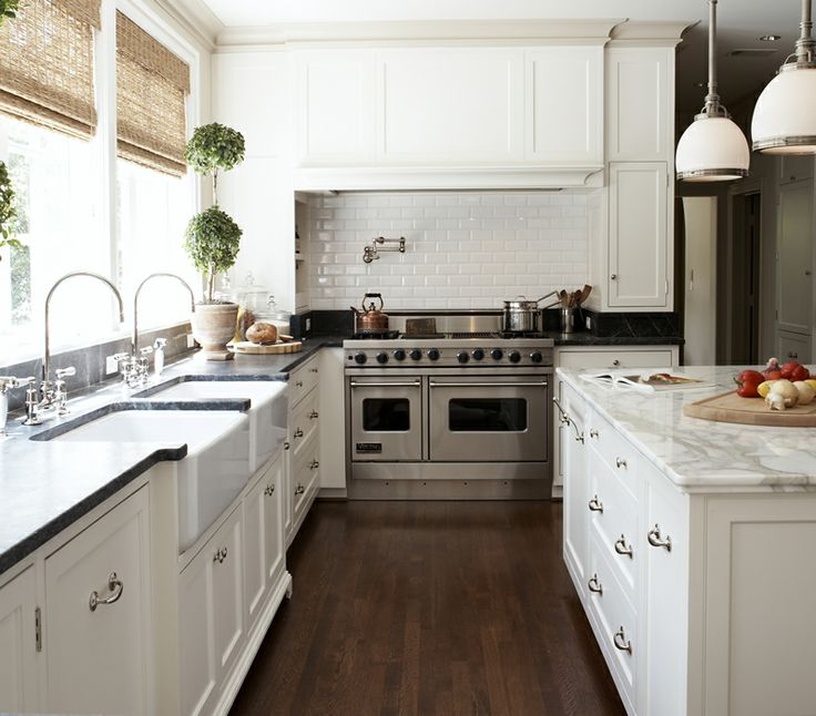 subway tile and marble...love the wall of windows...