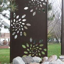 Olson Privacy Panels and Pergola Screen - Custom Laser Cut Steel Privacy Panels in Sunburst Design. Part of extensive landscape project.