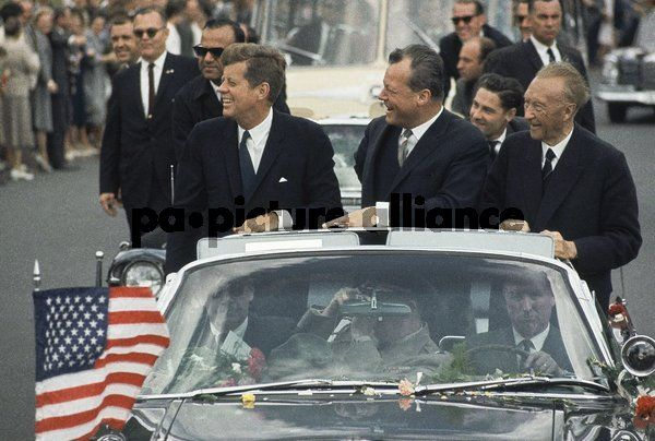 John F. Kennedy, standing in car with Mayor Willy Brandt and Konrad Adenauer...