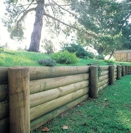 Wood retaining wall retaining walls porch yard for Wooden garden wall ideas