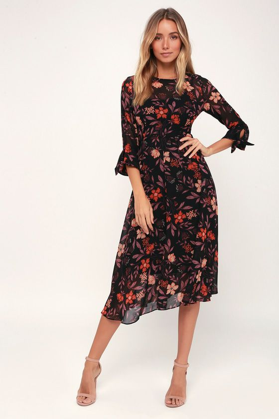 476fb2102c We re head over heels for the classic look of the I. Madeline Passionate Love  Black Floral Print Midi Dress! Elegant floral print three-quarter sleeve  midi.
