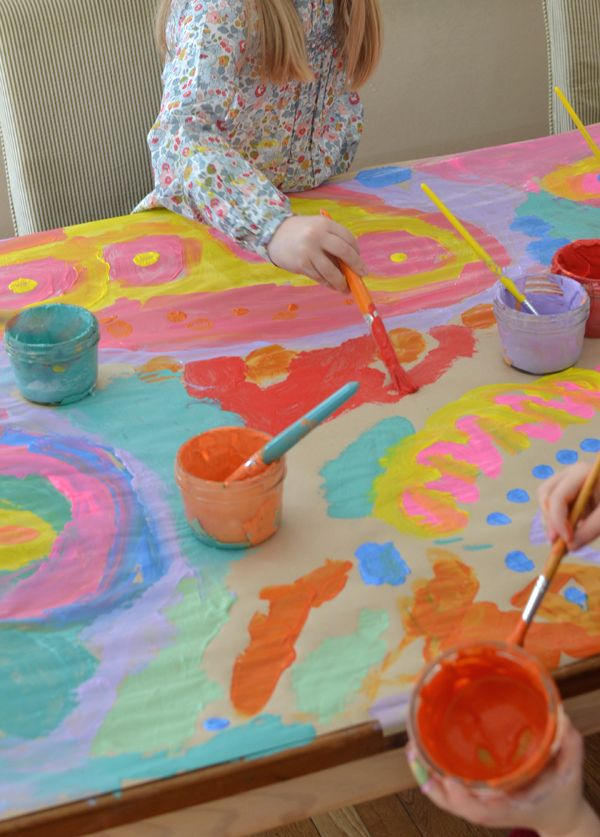 4yr olds work together to make a big painting ~ collaborative art projects foster cooperation, and they are so fun!!