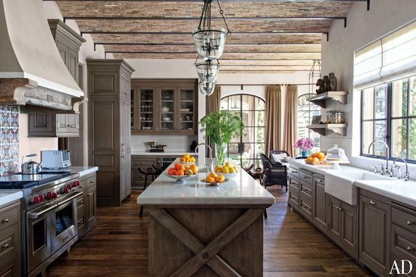 Inside Tom and Gisele's California Chateau: In the kitchen, a backsplash made with antique Tunisian tile adds color while an oak island and textured brick ceiling lend a rustic touch.