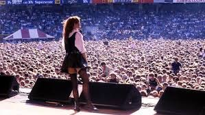 """The divine Chrissy Amphlett holding court at the MCG during the 1986/87 """"Australian Made"""" tour."""