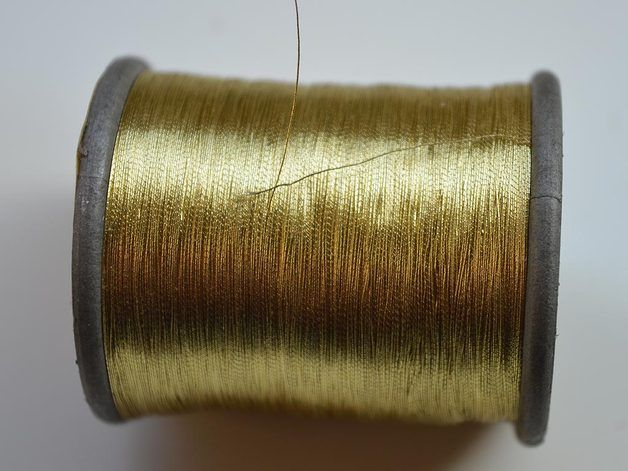 Metallic Golden Embroidery Thread. This thread is a also called Zari (Jari) is of premium quality is perfect for hand and machine embroidery. These can be used for craft purpose such as Tassels,...