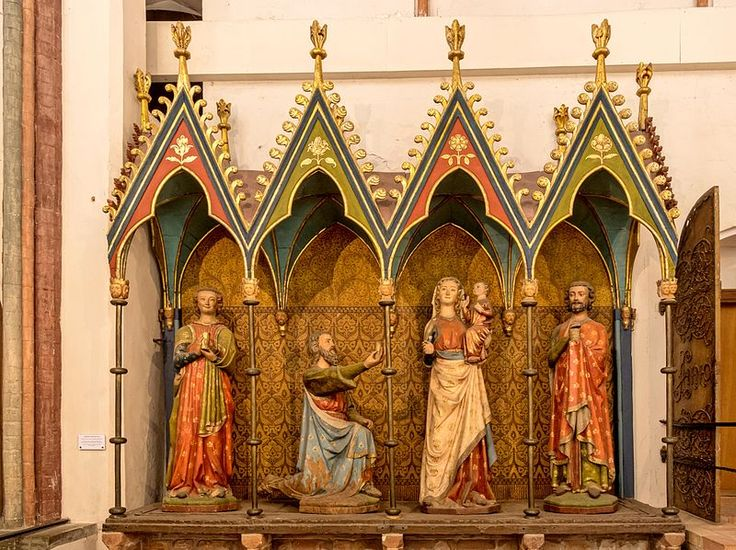 Three holy kings, a virgin and a child. Schleswig cathedral ca 1280. Notice the possible closed cloak on the leftmost beneath his surcote and the side-closed cloak on rightmost king. The arcade is probably a later addition. See also…