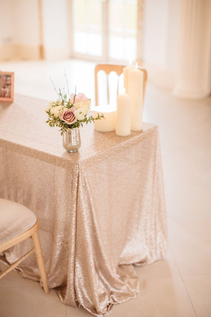 "A Blush Pink and Gold, Romantic Travel Inspired Wedding | Love My Dress® UK Wedding Blog  ""I think one of the most glamorous, dreamy and stunning things I hired for the day were the array of sequin table linen. I found Pudding Bridge online after lots of searching and Helen was most helpful! The range of colours and sizes are impressive! I was able to choose an ethereal champagne colour for the table in the ceremony room, which complimented the décor beautifully, without being overpowering."""