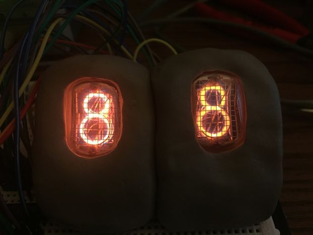 A Nixie Tube is a Neon gas-filled tube, that has a wiremesh anode with various cathodes shaped like numbers or symbols.  Back in the 1950s they were used in...